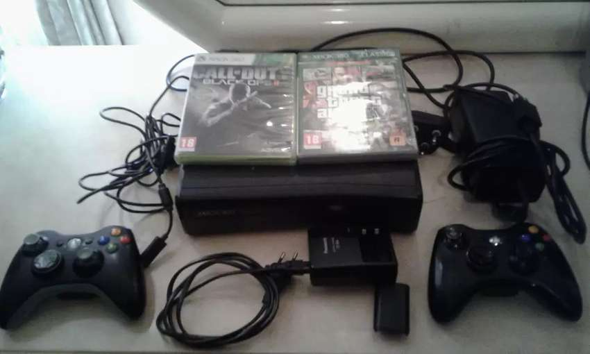 an Xbox360 console with 2 games, 2 controllers and etc 0