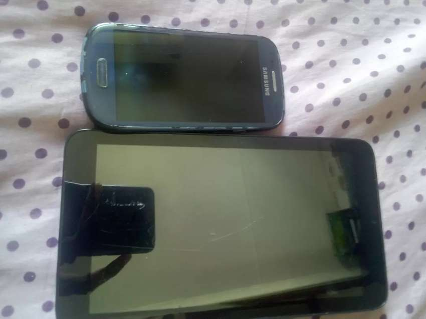Two broken phones...can be used for spares or can be replaced