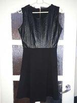 Śliczna skórzana sukienka rozmiar M. Polecam.