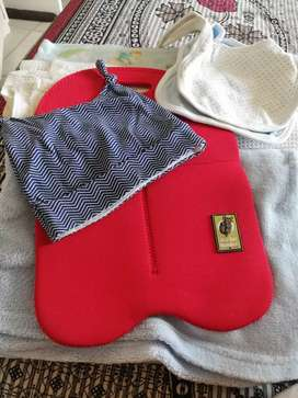Bib, cap, milk bottle cover nd 3 sheets.