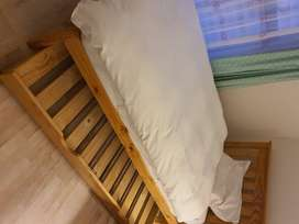 3/4 varnished pine bed, head board, pull out under bed, mattress