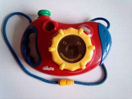 Chicco Film Camera. In smiley face shape.