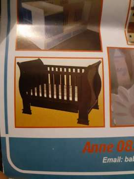 Mahogany sleigh cot with change station