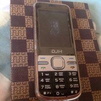 Продам двухстандартный телефон DGH