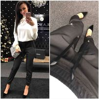 Czarne spodnie bojówki ze ściągaczami na nogawkach święta sylwester