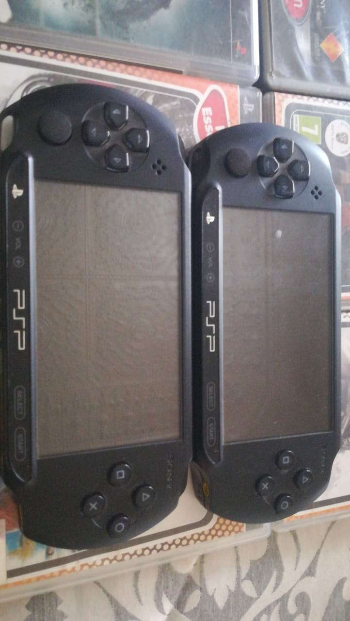 2 X PSP CONSOLES WITH 8 GAMES FOR SALE 0