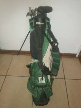 Wilson golf clubs with bag and stand