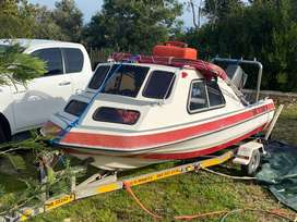 Cabin boat and trailer for sale