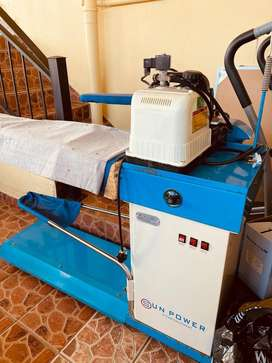 Sale of industrial steam iron, boiler and table.