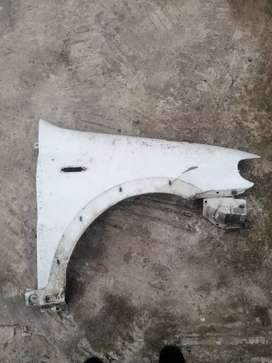 Fiat strada driver side fender small dent R250