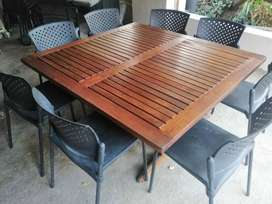 Lovely wooden designed outdoor table with 8 black chairs