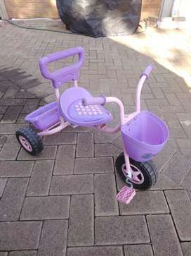 Toddler Tricycle and pink plastic bike