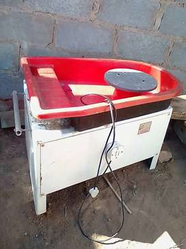 Potters wheel electrically powered with foot operated pedal