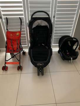 Baby Jogger City Mini pram with car seat and red stroller