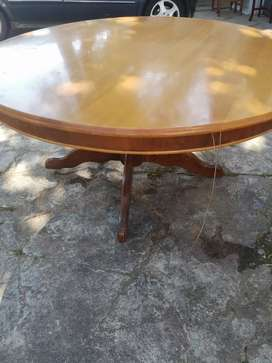 Yellow wood round dining table