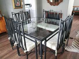 Glass and steel dining table and chairs