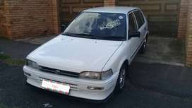1998 Toyota Tazz, white, 1300 with 13 inch rims, in mint condition