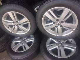 A set of 15 inch Polo tsi mags and tyres it's 98% life