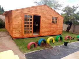 BBC Wendy house and logs