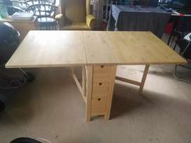 Wooden drawer fold into a cupboard / table