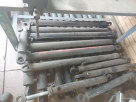 Side tipping silinders