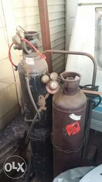 Image of Oxy acetylene gas bottles and stand and guages