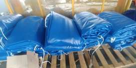 QUALITY PVC TRUCK COVERS/TARPAULINS AND CARGO NETS FOR TRI-AXLE