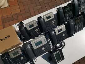 11x Yealink IP Phones (With PoE) incl a switch board and exp module