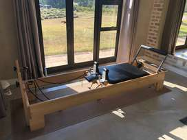 Balanced Body Reformer. Box, foot and hand straps and mat included.
