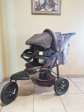 Chelino Stroller with baby carrier.