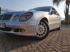 Mercedes Benz E200  auto low kilos fsh original condition at R69900