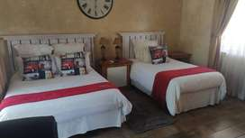 A fully furnished bedroom with private bathroom