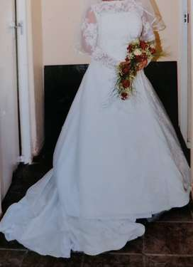 White wedding dress with extension to the dress