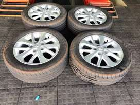 A set of original 16 inch Toyota corolla rims with tyres