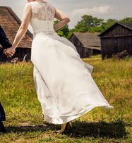 Suknia ślubna w kolorze śmietanowej bieli