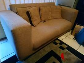 Beige two seater couches