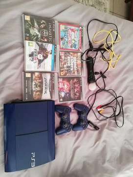PS 3 Slim with Games and Remotes