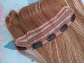 Synthetic clip in hair piece.