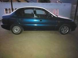 Its a blue daewoo lanos, 2002 model with neat interior full house