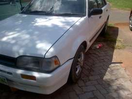 Mazda 323 in good running condition.