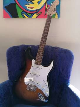 Fender Squier Stratocaster Electric Guitar and Fender Amp