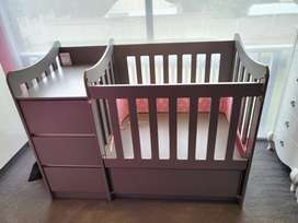 Baby cot with side drawers