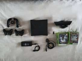 Xbox 360, Kinect, 2 Controllers, 1 Game Wheel, 17 Games ( negotiable)