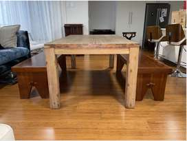 Wooden dining room table and benches