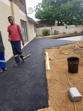 Tar surfaces and bricks paving Drive ways etc