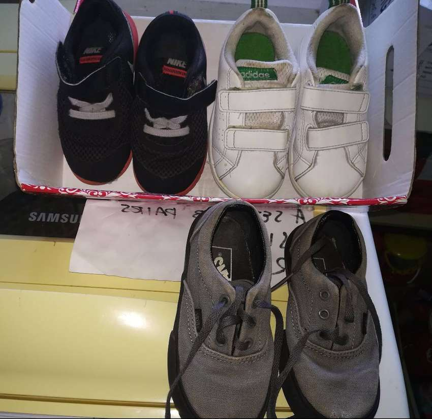 3 pairs of Boys Toddler Sneakers  size 6 and a pair of rain boots 0