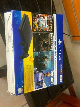 Brand New Playstation 4 Slim with 2x Controllers & 2x Games included..
