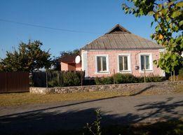 Продам дом в центре смт. Арбузинка