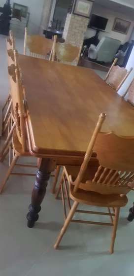 Yellow wood table with 10 chairs