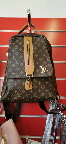 Louis Vuitton backpack and matching Duffel bag